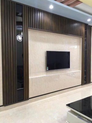 Tấm PVC vân đá + Lam nhựa giả gỗ ốp phòng khách